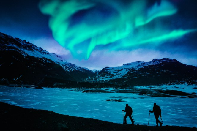Hikers Under the Northern Lights